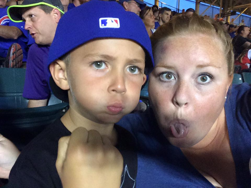 Megan and her nephew at his first Cubs game.